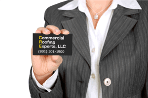 Commercial Roofing Experts CEO with business card